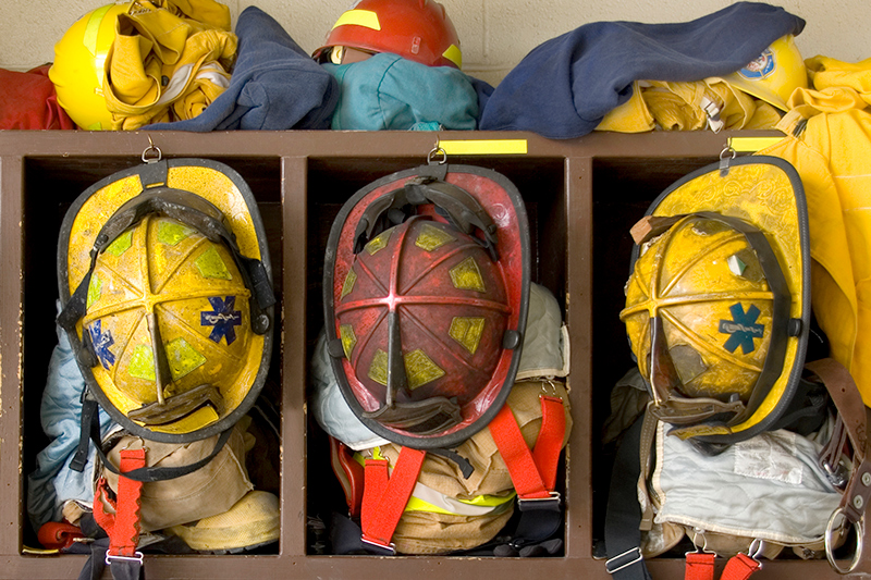 Fireman hats and gear in lockers