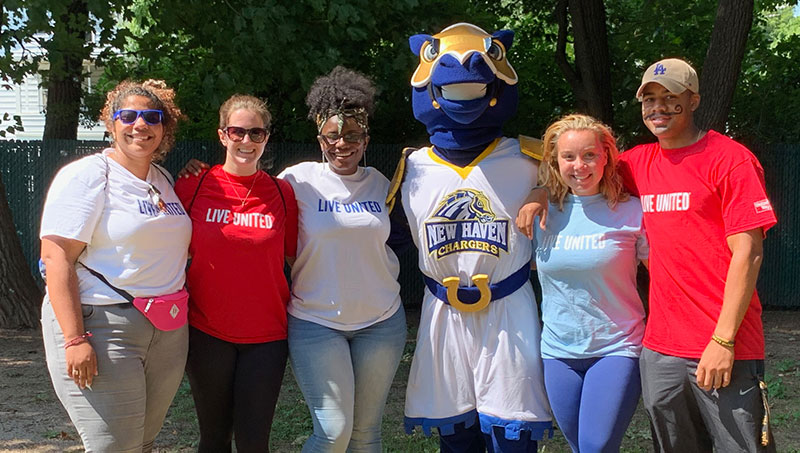 Image of University of New Haven students and Charlie