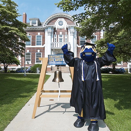 Charlie the charger mascot in front of Maxcy Hall