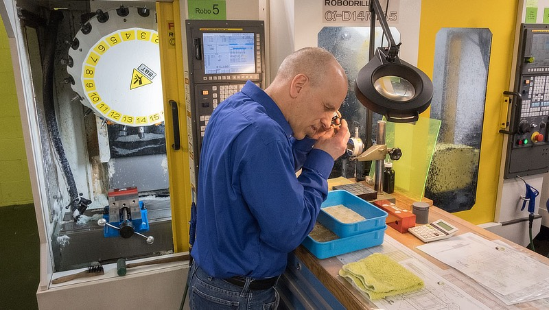 Image of Mark Rohlfs in front CNC machining center.