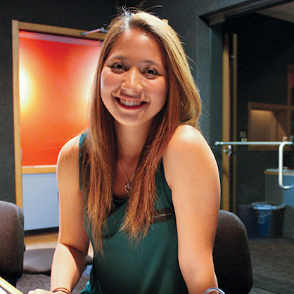 An image of communications alumnus, Cara Demers '16.