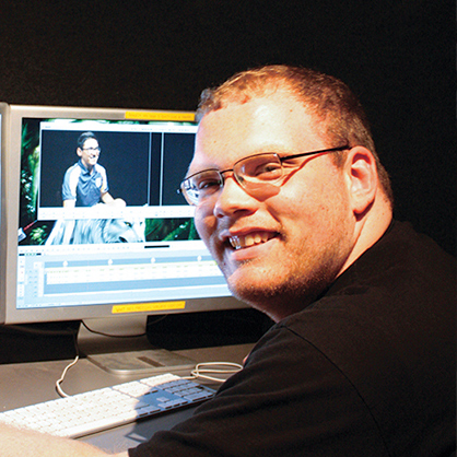 An image of communications alumnus, Joseph Brown. He experienced professional training in communication and media studies with state-of-the-art facilities and real-world experience.