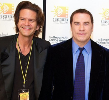 Tom Garrett with John Travolta at Sunscreen Film Festival. Image courtesy of celebrityimages.org.